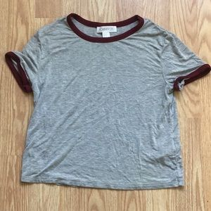 Grey and maroon cropped t shirt.